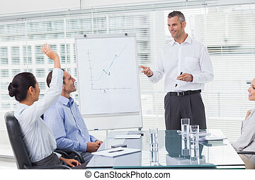 Businesswoman asking question during her colleagues...