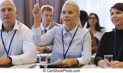 businesswoman at business conference speaking - business,...