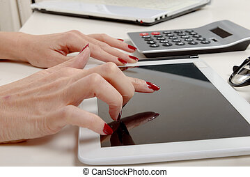 businesswoman at the office working on tablet