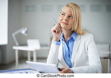 Businesswoman at work - Young pensive businesswoman sitting...