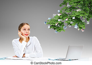 Businesswoman  at workplace and money symbols
