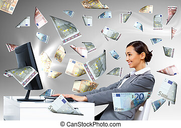 Businesswoman at workplace and money symbols - Young...