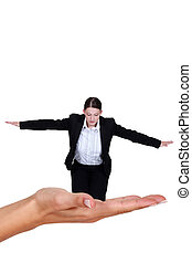 Businesswoman balancing in the palm of a hand