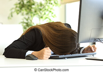 Businesswoman banging the head against the table -...