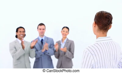 Businesswoman being congratulated