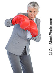 Businesswoman boxing with her boxing gloves