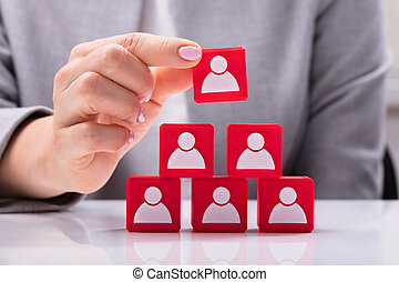 Businesswoman Building Blocks Of A Team