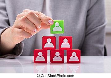 Businesswoman Building Pyramid