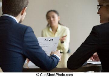 Businesswoman, businessman HR managers interviewing asian woman