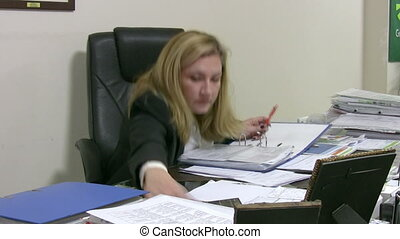 Businesswoman calculating data