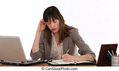 Businesswoman calculating her bills and it makes her nervous