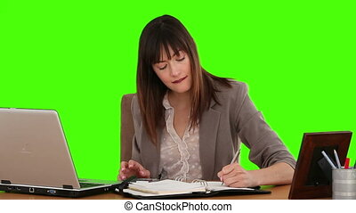 Businesswoman calculating her bills and it makes her smilling