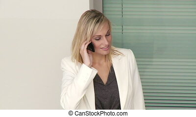 Businesswoman calling by phone