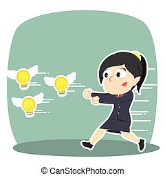 Businesswoman chasing flying ideas