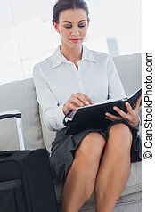 Businesswoman checking her diary