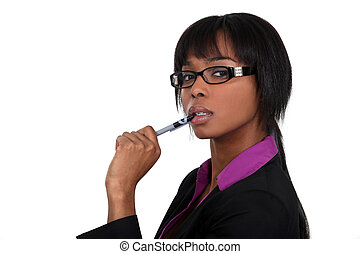 Businesswoman chewing on her pen