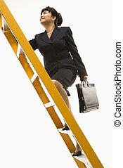 Businesswoman climbing ladder. - Filipino middle-aged...