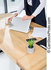 businesswoman closing laptop