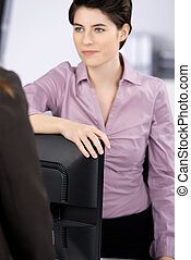 Businesswoman Communicating With Coworker