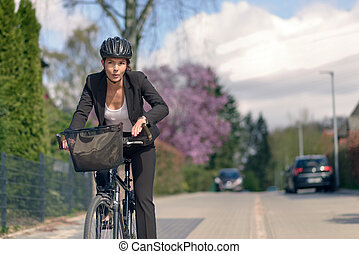 Businesswoman Commuting on a Cycle Going to Office - Young...