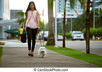 Businesswoman Commuting To Office With Her Dog