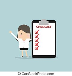 Businesswoman completing a checklist ticking al the boxes.