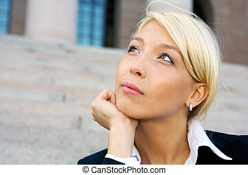 Businesswoman contemplating - Businesswoman sitting outside...