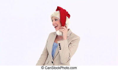 Businesswoman dancing while wearing a Santa Claus hat