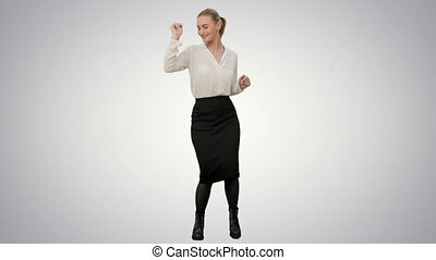 Businesswoman dancing wildly celebrating successful project on white background.