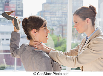 Businesswoman defending herself from her co worker...