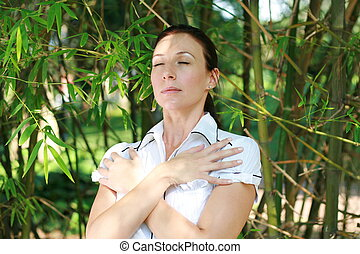 businesswoman destressing - a businesswoman with arms over...