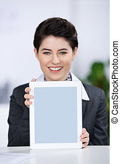 Businesswoman Displaying Digital Tablet At Counter