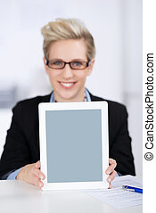 Businesswoman Displaying Digital Tablet At Desk