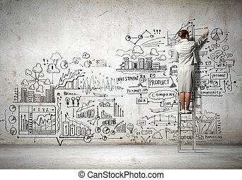 Back view of businesswoman drawing sketch on wall