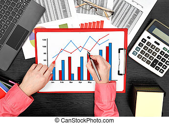 businesswoman drawing stock chart