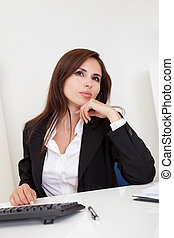 Businesswoman dreaming at workplace