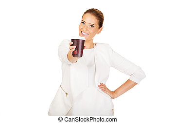 Businesswoman drinking coffee from paper cup