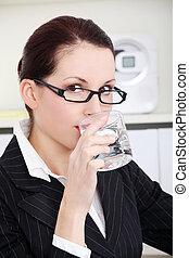 Businesswoman drinking water.