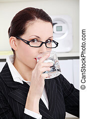 Businesswoman drinking water.