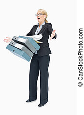 Businesswoman dropping many folders on white background