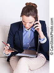 Businesswoman during mobile phone call - Busy businesswoman...
