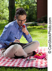 Businesswoman eating lunch outdoors