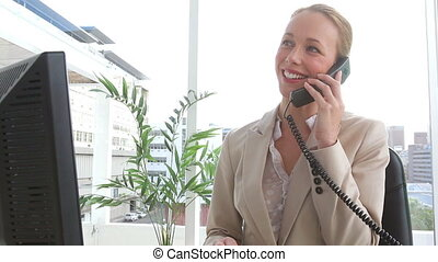 Businesswoman ending a phone call in an office
