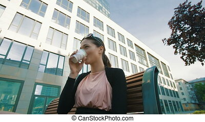 Businesswoman enjoying coffee