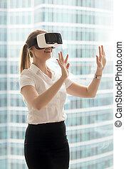 Businesswoman enjoying virtual tour in VR headset