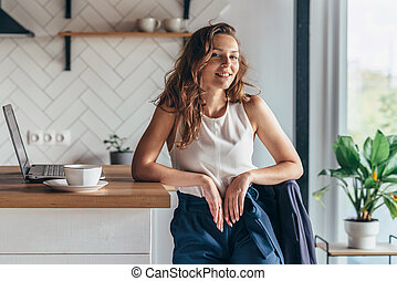 Businesswoman entrepreneur working on laptop from home.