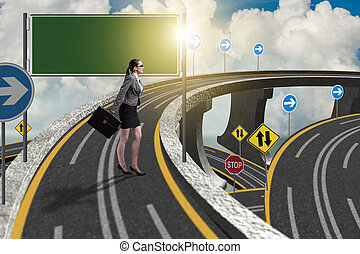 Businesswoman facing many different roads