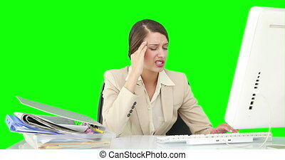Businesswoman feeling stressed at her desk on green screen...