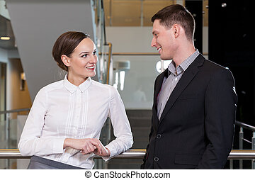 Businesswoman flirting with her workmate