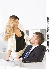 Businesswoman flirting with work colleague